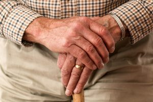 Elderly Care - Male Pensioner with walking stick